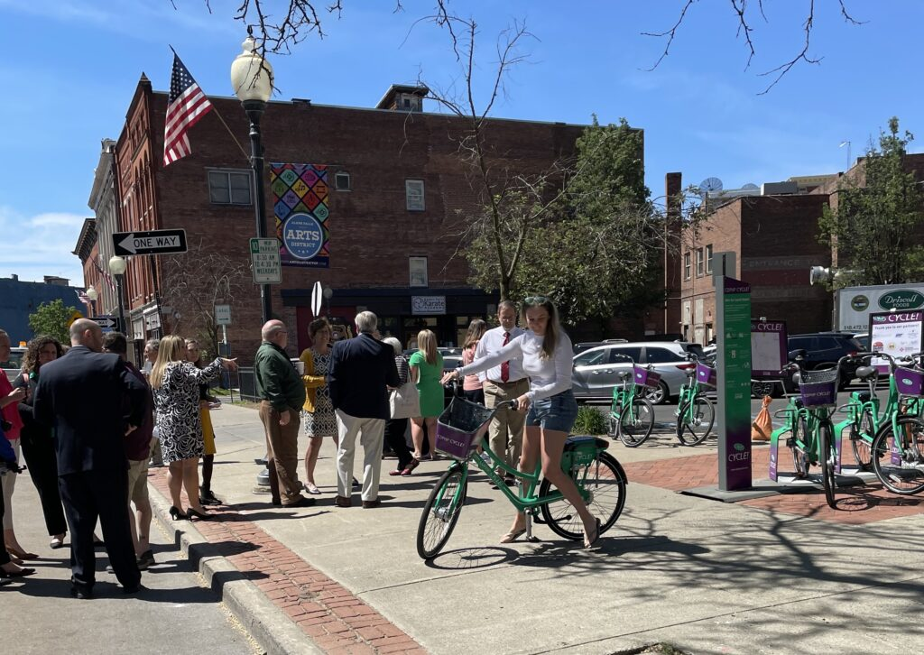 Girl trying out bike in Downtown Glens Falls