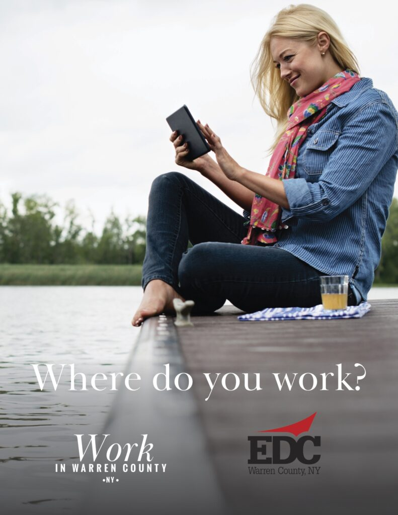 Woman on phone lakeside