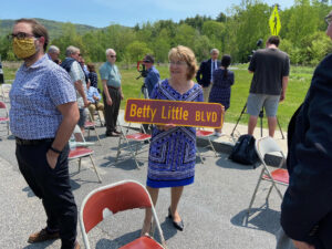 Betty Little holding her road sign